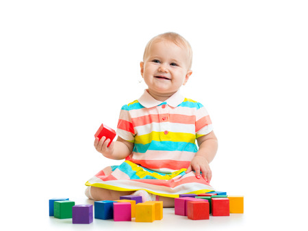 child playing with block toys photo