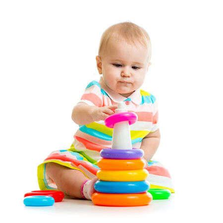 child playing toy isolated on white photo