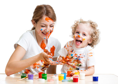 funny mother and kid girl painting together Stock Photo