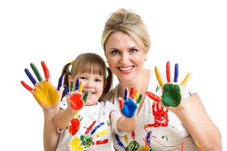 Mother with kid showing painted palms Stock Photo