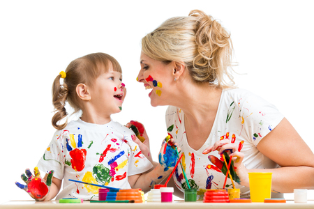 Mother with kid painting and have fun pastime photo