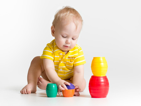 child playing: little child playing with toys
