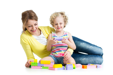 kid and mother playing together with construction set toy photo