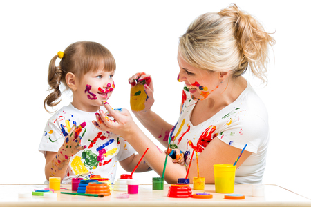 soiled: Mother with kid paint together Stock Photo