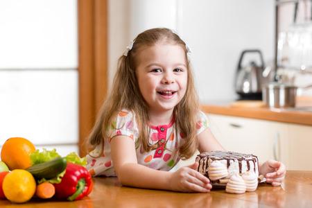 limon: kid choosing between healthy vegetables and tasty sweets