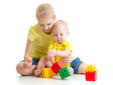 nursing sister: kid girl playing with her little brother