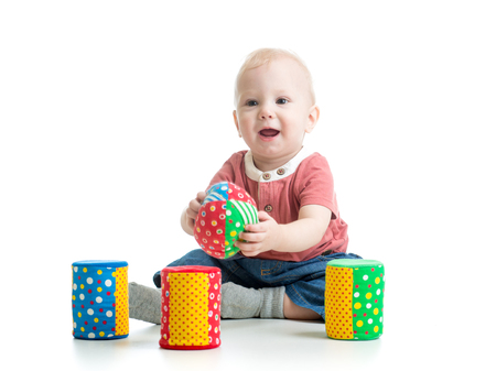 little kid playing with building blocks photo