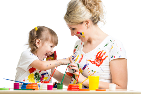 Kid with parent paint together photo