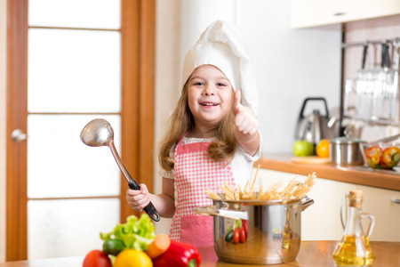 Chef girl preparing healthy food and showing thumb up photo