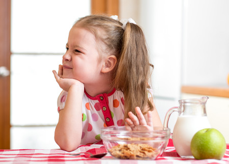 rebelling: kid girl refuses to eat healthy food