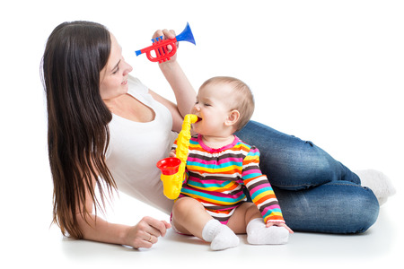 babies playing: baby and mom play musical toys Stock Photo