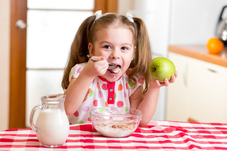 corn flakes: happy kid eating corn flakes with milk