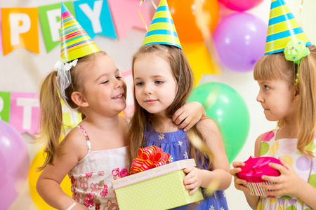 pretty children giving gifts on birthday party Stock Photo - 26269989