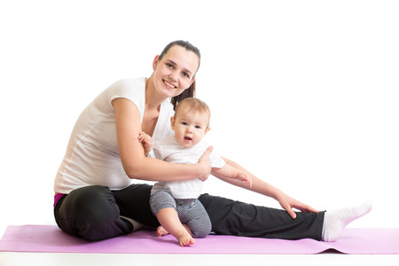mom with baby doing gymnastics and fitness exercises Stock Photo - 26508055