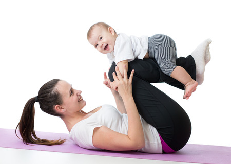 gymnastics sports: mom with baby doing gymnastics and fitness exercises Stock Photo