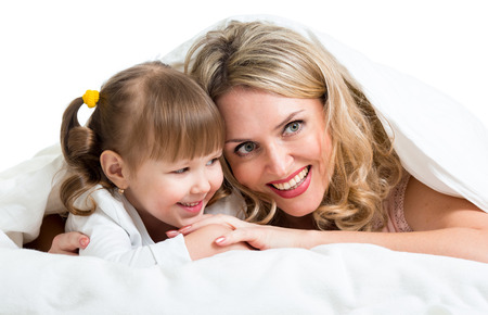happy mother and child lie in the bed photo