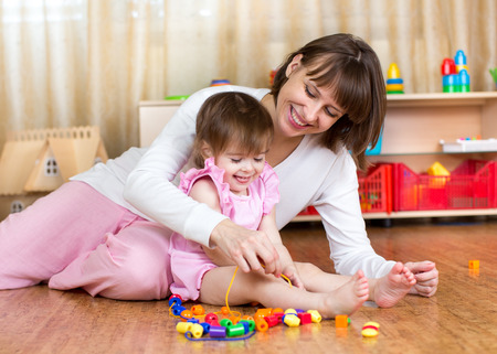 happy mother and kid play together photo