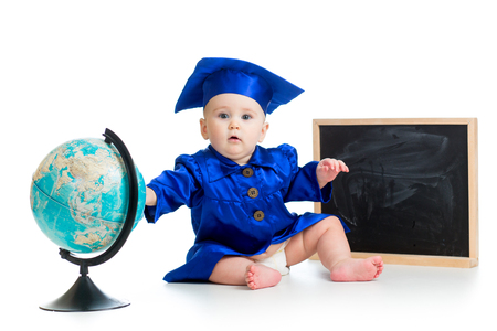 Baby in academician clothes  with globe and chalkboard photo