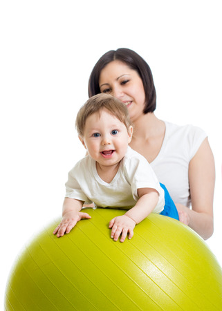 large ball: mother with baby having fun with gymnastic ball Stock Photo