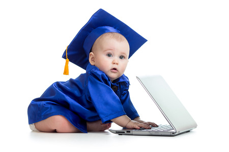 funny baby in academician clothes  using laptop photo
