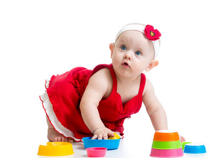 Funny baby playing with toys photo