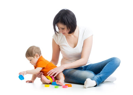 kid and mother play together with cup toys photo