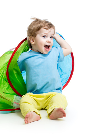 six month old: cheerful baby playing in a tent Stock Photo