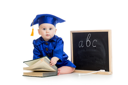 Baby in academician clothes  with book and chalkboard photo