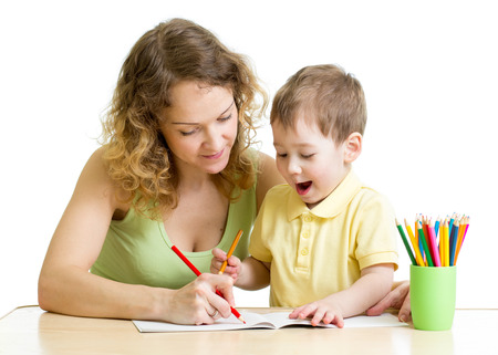 child boy and mother draw with colorful pencils photo