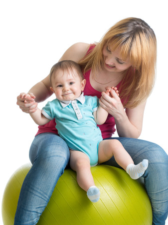 large ball: mom and baby having fun with  gymnastic ball
