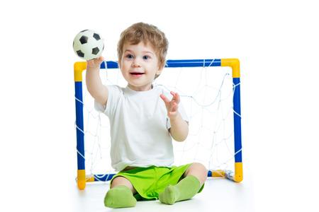boy ball: kid football player holding soccer ball