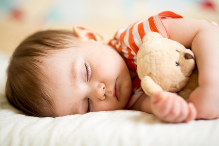 plush toy: infant baby boy sleeping