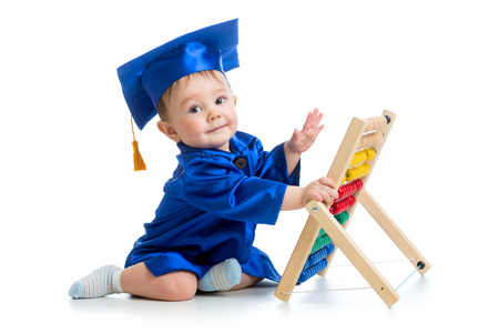 academic baby playing with abacus toy photo