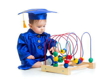 Baby in academician clothes  with educational toy photo