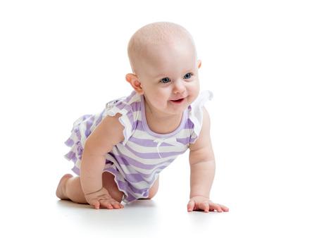crawl: beautiful baby girl crawling on floor over white