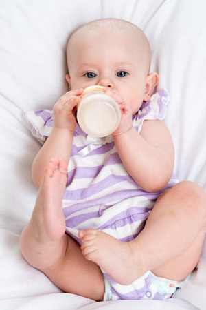 pretty baby: adorable child drinking milk from bottle