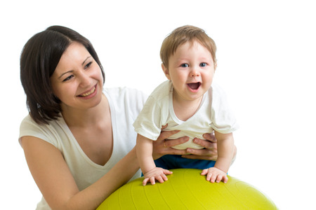 large ball: mother doing gymnastics with baby  on fitness ball
