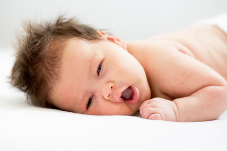3 month: adorable newborn baby lying on stomach