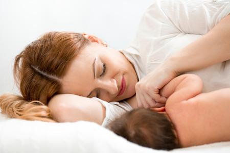young breast: happy mom breast feeding newborn baby