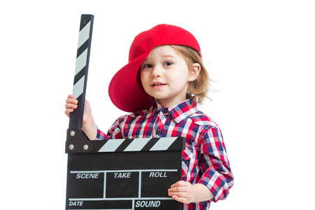 Kid girl holding clapper board in hands isolated photo