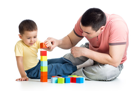 wood block: kid and his dad play with building blocks