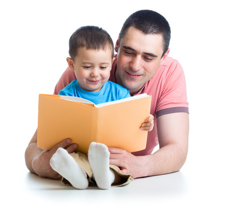dad reading a book to kid photo