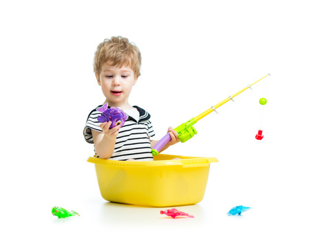 Cute little baby fishing and sitting inside washbowl photo