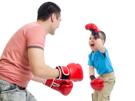 family activities: Father and kid son play with boxing gloves