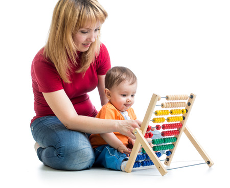 mother and baby boy play with counter toy photo