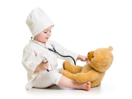 child girl playing doctor with toy photo