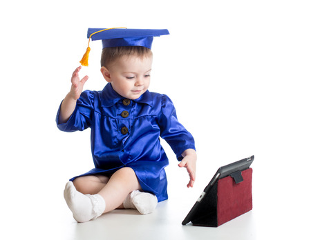 baby with academic clothes playing tablet PC photo