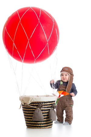 baby with pilot hat on hot air balloon photo