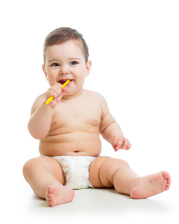 sweet tooth: toddler boy brushing teeth Stock Photo