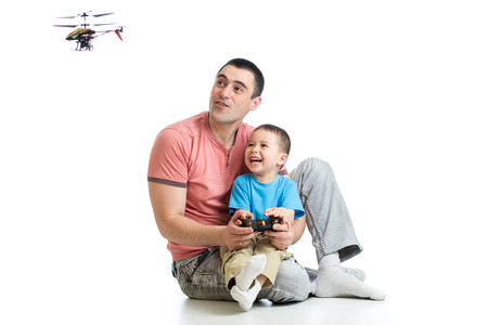boys toys: Father and son playing with RC helicopter toy